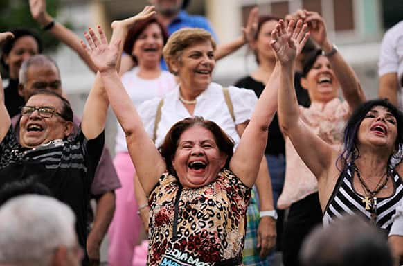 People attend a laugh therapy session in a public square in Caracas, Venezuela.