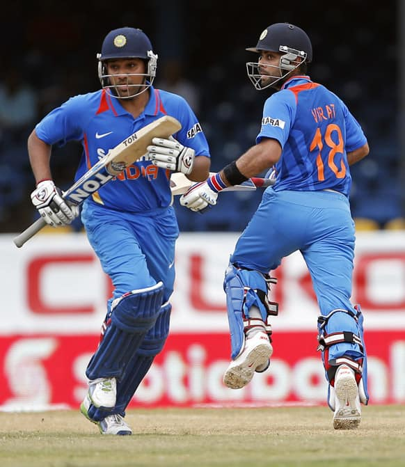 Virat Kohli and Rohit Sharma run between the wickets during the Tri-Nation Series cricket match against Sri Lanka in Port-of-Spain, Trinidad.