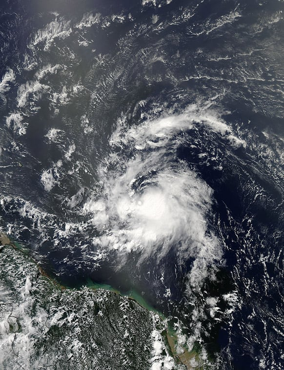 This image provided by NASA shows Tropical Storm Chantal taken at 1 p.m. EDT Monday July 8, 2013. The fast-moving tropical storm raced toward the small islands of the Lesser Antilles on Tuesday, with residents of St. Lucia shuttering schools and preparing to close the island`s two airports as it neared.