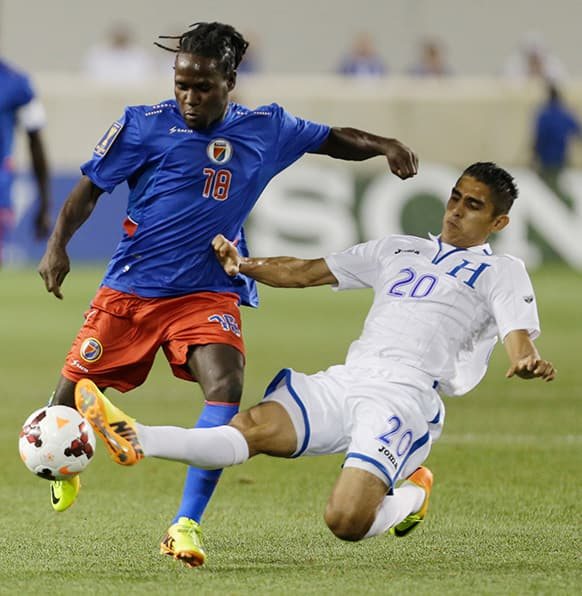 Honduras` Jorge Juarez, right, defends against Haiti`s Leonel Saint Preux during the first half of a CONCACAF Gold Cup soccer match, in Harrison.