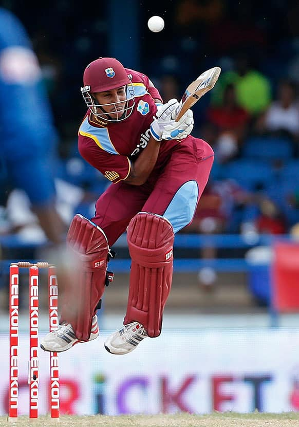West Indies` Lendl Simmons jumps while trying to drive a wide delivery off Sri Lanka`s Lasith Malinga during their Tri-Nation Series cricket match in Port-of-Spain, Trinidad.