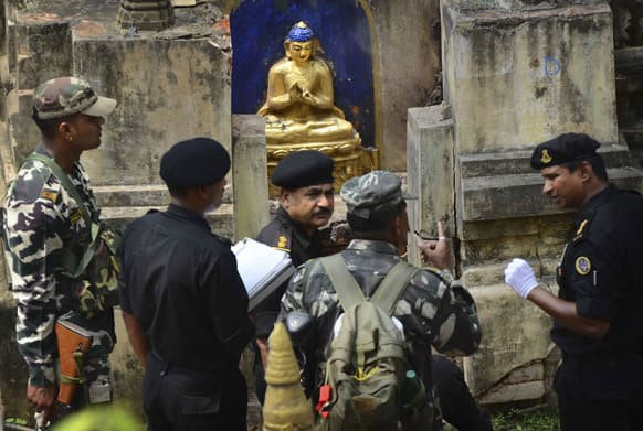 National Security Guards inspect the site of a blast at the Mahabodhi Temple or the great Awakening Temple complex, in Bodhgaya, about 130 kilometers (80 miles) south of Patna, the capital of the eastern Indian state of Bihar.