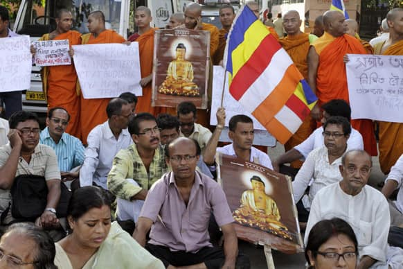 Buddhists and monks stage a silent protest against the series of blasts in Bodhgaya, in Kolkata.