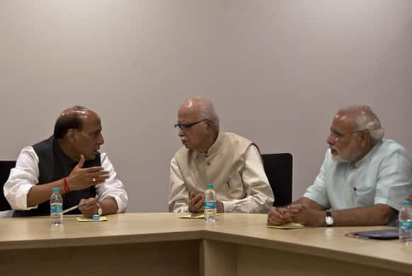 India's main opposition Bharatiya Janata Party (BJP) President Rajnath Singh, party leader L.K. Advani and Gujarat state Chief Minister Narendra Modi attend the party`s parliamentary board meeting in New Delhi.