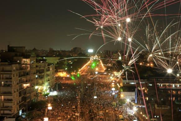 Fireworks burst over opponents of Egypt`s Islamist President Mohammed Morsi during a rally outside the Presidential palace in Cairo, Egypt.