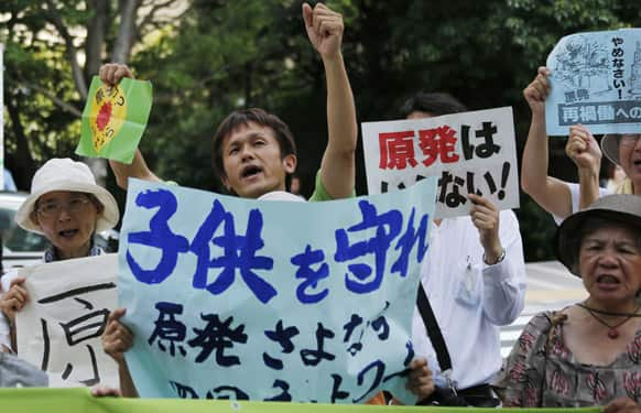 Protesters shout slogans during an anti-nuclear rally in front of the Nuclear Regulation Authority (NRA) in Tokyo.