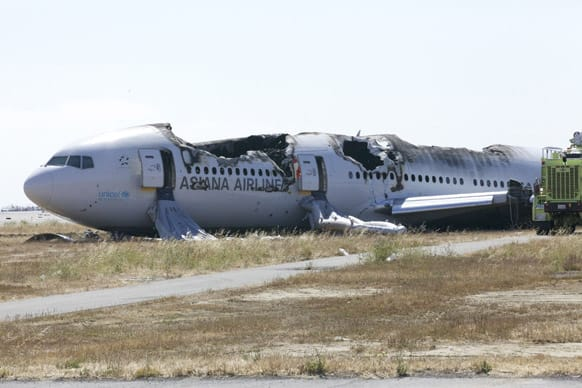 This image provided by the NTSB, the wreckage of the Asiana Airline flight 214 is seen Sunday July 7, 2013. The Asiana flight crashed upon landing, at San Francisco International Airport, and two of the 307 passengers aboard were killed.