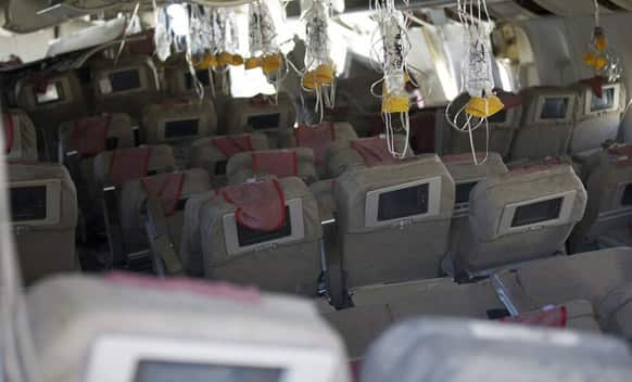 This image released by the National Transportation Safety Board, Sunday, July 7, 2013, shows the interior of the Boeing 777 Asiana Airlines Flight 214 aircraft. The Asiana flight crashed upon landing, at San Francisco International Airport, and two of the 307 passengers aboard were killed.