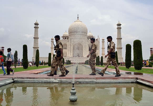 Indian paramilitary soldiers patrol the premises of the Taj Mahal in Agra, after a series of blasts in Bodhgaya.
