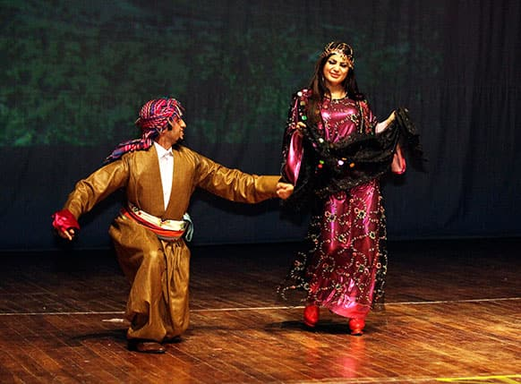Dancers wearing traditional Iraqi folk costumes perform during a celebration of the Iraqi capital becoming this year`s Arab Capital of Culture in Baghdad.