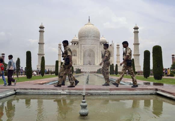 Paramilitary soldiers patrol the premises of the Taj Mahal in Agra.