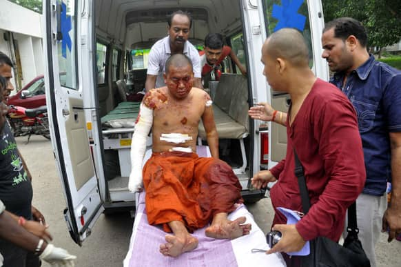 A Buddhist monk is carried on a stretcher for treatment after he was injured in an explosion in Bodhgaya, about 130 kilometers (80 miles) south of Patna, the capital of the eastern Indian state of Bihar.