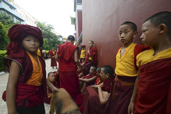 Novice Buddhist monks wait outside the Tergar Monastery, the site of an explosion, in Bodhgaya, about 130 kilometers (80 miles) south of Patna, the capital of the eastern Indian state of Bihar.