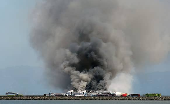 Smokes rises from Asiana Flight 214 after it crashed at San Francisco International Airport in San Francisco.