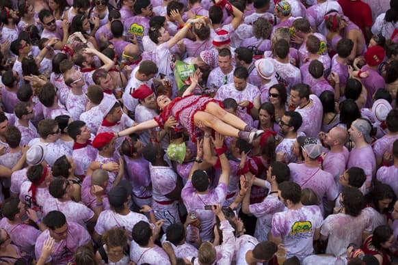 A girl is lifted above the crowd during the launch of the