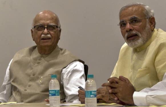 Gujarat Chief Minister Narendra Modi and BJP Leader L.K. Advani attend the party`s parliamentary board meeting in New Delhi.
