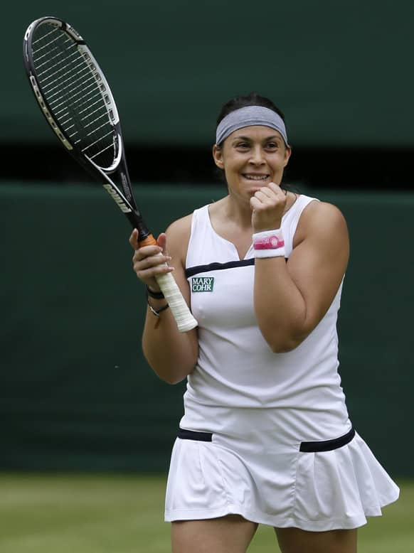 Marion Bartoli of France reacts after defeating Kirsten Flipkens of Belgium during their Women`s singles semifinal match at the All England Lawn Tennis Championships in Wimbledon, London.