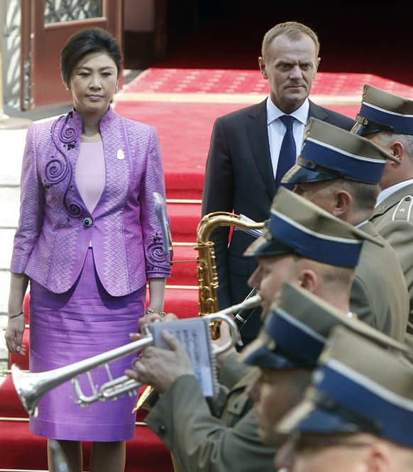 Polish Prime Minister Donald Tusk and his counterpart of Thailand Yingluck Shinawatra attend a welcoming ceremony in Warsaw, Poland.