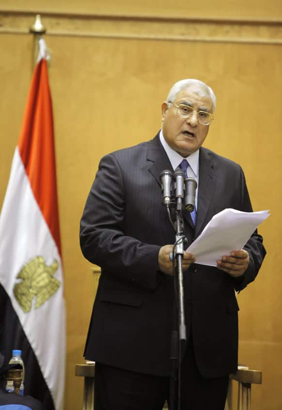 Egypt`s chief justice Adly Mansour speaks at his swearing in ceremony as the nation`s interim president. The chief justice of Egypt`s Supreme Constitutional Court was sworn in Thursday as the nation`s interim president, taking over hours after the military ousted the Islamist President Mohammed Morsi.