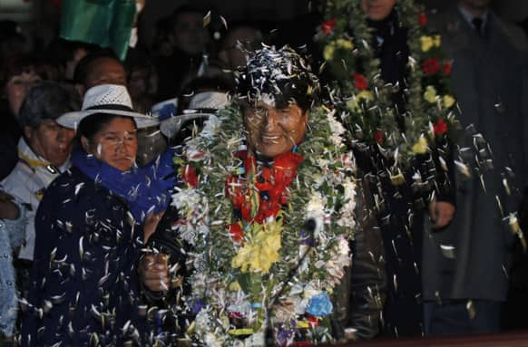 Bolivia`s President Evo Morales is welcomed upon his arrival home after an unplanned 14-hour layover in Vienna at the airport in El Alto, Bolivia.