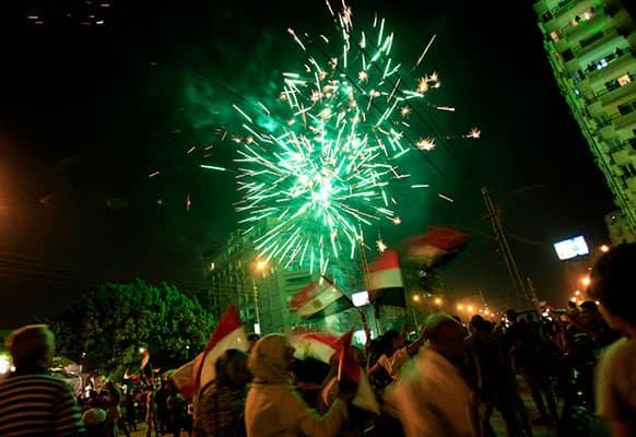 Fireworks light the sky as opponents of Egypt`s Islamist leader Mohammed Morsi celebrate outside the presidential palace in Cairo, Egypt.