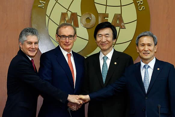 From left to right, Australian Defense Minister Stephen Smith, Australian Foreign Minister Bob Carr, South Korean Foreign Minister Yun Byung-se and South Korean Defense Minister Kim Kwan-jin shake hands before their meeting at the Foreign Ministry in Seoul, South Korea.