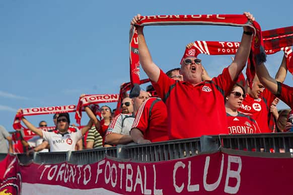 Toronto FC fans sing the national anthem ahead of their MLS soccer game against the Montreal Impact in Toronto.