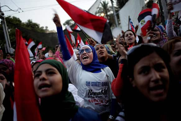 Opponents of Egypt`s Islamist President Mohammed Morsi chant slogans as they celebrate outside the presidential palace in Cairo, Egypt.
