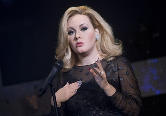 The wax figure of British singer Adele is revealed at Madame Tussauds in central London.