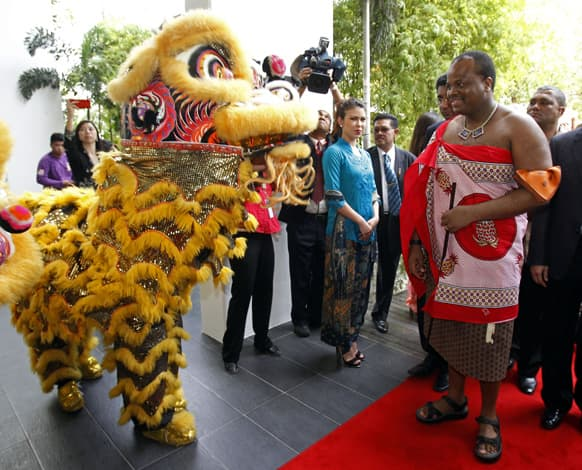Swaziland`s King Mswati III, right, watches a lion dance performance as he visits to Taylor`s University in Subang Jaya, near Kuala Lumpur, Malaysia. The Swaziland`s King is on a five-day working visit to Malaysia.