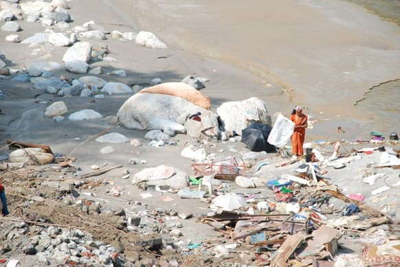 A woman tries to salvage, the little that is left of her belongings in Chandrapuri Village/ Town, Rudraprayag District. Her house stood on the river front have been completely washed away by the June 16th Floods. Photo Credit: Siddharth Behl/ SEEDS