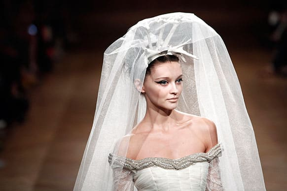 A model wears a wedding dress by Venezuelan fashion designer Oscar Carvallo as part of his Haute Couture Fall-Winter 2013-2014 collection.