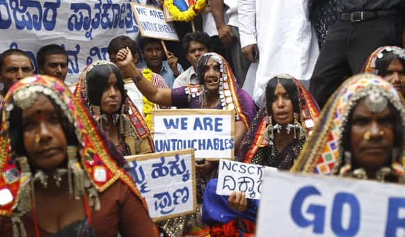 Tribal women of the Banjara community shout slogans demanding their rights during a protest outside the venue of a public hearing held by the National Commission of Scheduled Castes in Bangalore.