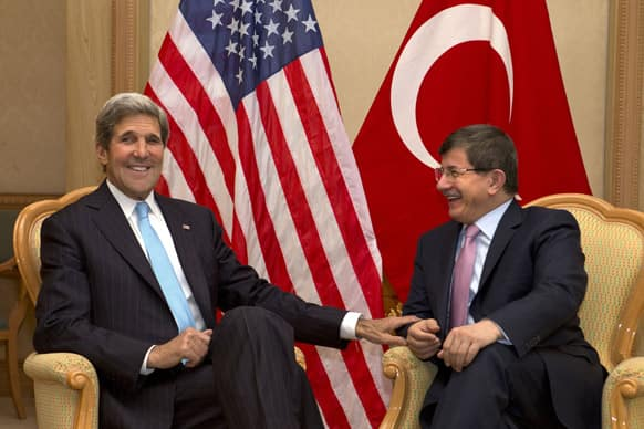 US Secretary of State John Kerry, meets with Turkey`s Foreign Minister Ahmet Davutoglu before attending ASEAN security meetings in Bandar Seri Begawan, Brunei. Kerry is expected to start the return to Washington Tuesday afternoon.