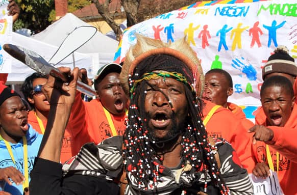 Mamogodi Sello, center, with a youth group sing outside the Mediclinic Heart Hospital where former South African President Nelson Mandela is being treated in Pretoria, South Africa.