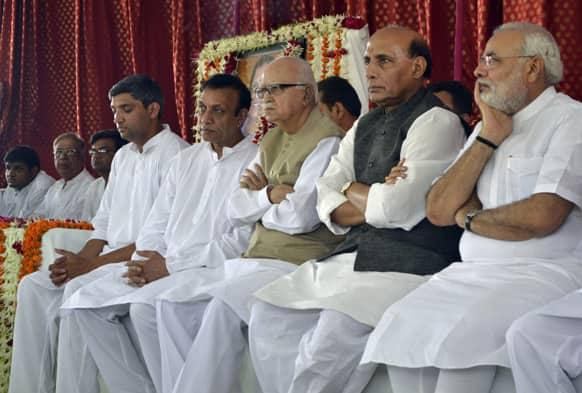 Bharatiya Janata Party (BJP) leader L.K. Advani, third right, party President Rajnath Singh, second right, and Chief Minister of Gujarat state Narendra Modi, right, attend the condolence meet of former Union minister and party colleague Bhavna Chikhalia at Junagadh.