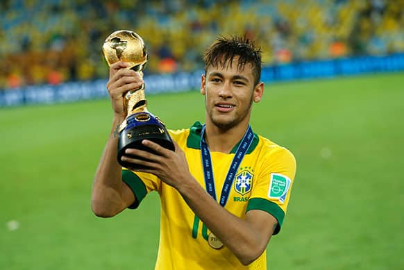 Brazil`s Neymar holds the trophy after winning the soccer Confederations Cup final between Brazil and Spain at the Maracana stadium in Rio de Janeiro, Brazil.
