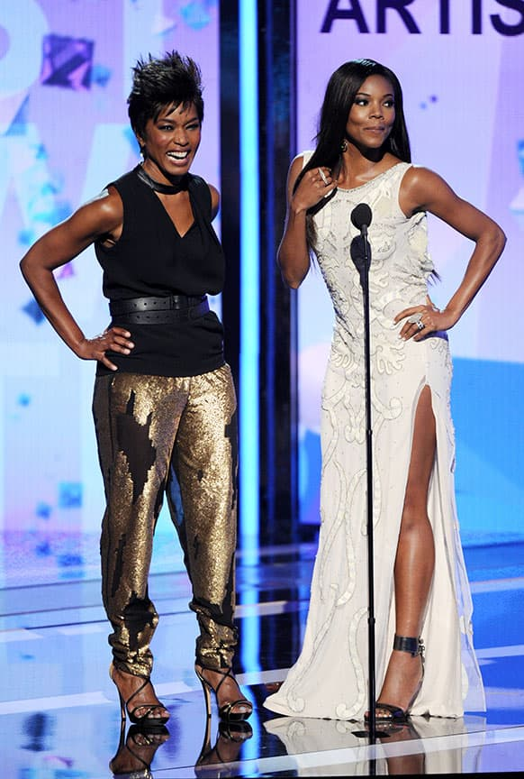 Angela Bassett, left, and Gabrielle Union speak on stage at the BET Awards at the Nokia Theatre in Los Angeles.