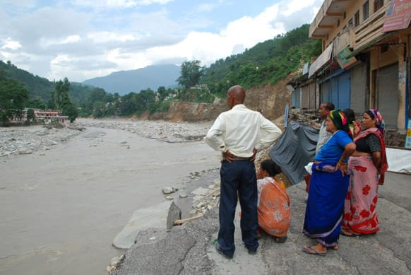 At Rudraprayag -stranded people watch nature`s fury. Photo Courtesy: Siddharth Behl/SEEDS