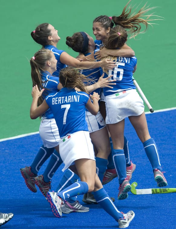 Italy players celebrate after scoring the winning penalty shot during their game against South Africa during the Investec World League Semi Finals, in Chiswick, London.