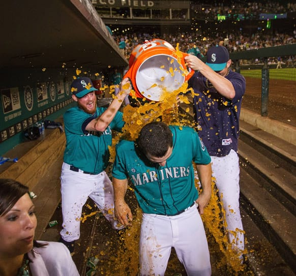Mike Zunino is doused with a Gatorade bath after scoring the winning run in the tenth inning with a walk off single in a baseball game against the Chicago Cubs.