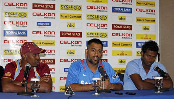 India`s cricket team captain Mahendra Singh Dhoni, center, speaks as his counterparts Angelo Mathews of Sri Lanka, right, and Dwayne Bravo of the West Indies listen during the launching of the Tri-Nation cricket tournament in Kingston, Jamaica.