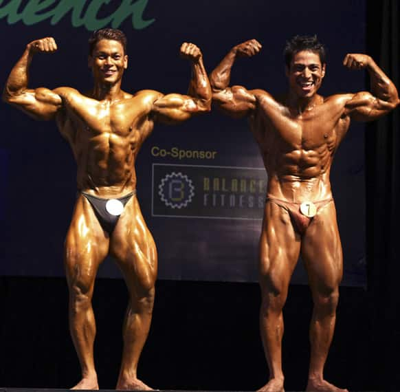 Bodybuilders compete during their bodybuilding contest organized by Myanmar Bodybuilder Federation at Myanmar Convention Center (MCC) Thursday, June 27, 2013, in Yangon.