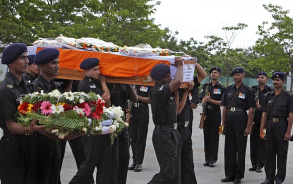 Indian army soldiers pay their last tributes to fellow soldier Yadaiah. M, as his body is taken for final rites, in Hyderabad. Yadaiah was among five soldiers who were killed on June 24, 2013 in an attack by militants on their army convoy in Srnagar.
