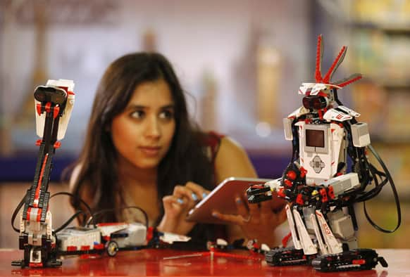 A Hamleys employee steers the Lego Mindstorms EV3 with an iPad application at the toy store Hamleys in London.