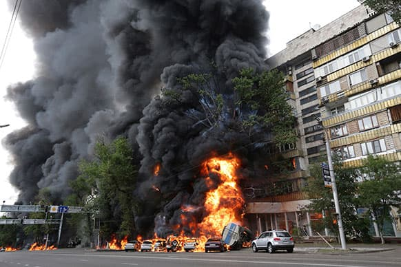 A multi-story building is engulfed by flames after a road accident in downtown Almaty, Kazakhstan. According to witnesses, the fire was a result of a petrol tank lorry that exploded near Rixos hotel at the crossing killing one person and destroying 20 apartments.