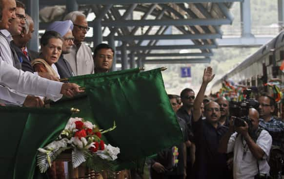 Prime Minster Manmohan Singh and Congress party President Sonia Gandhi flag off the first train connecting Qazigund to Banihal during the train service inauguration, in Banihal some 120 kilometers south of Srinagar.
