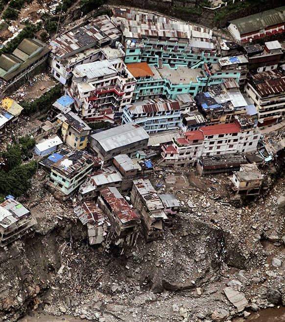 A view of damaged houses is seen following monsoon rains in Shrinagar. Authorities prepared Tuesday to cremate the bodies of hundreds of people who perished in monsoon flooding in northern India, as soldiers attempted to rescue tourists and pilgrims who remained stranded in a remote town.