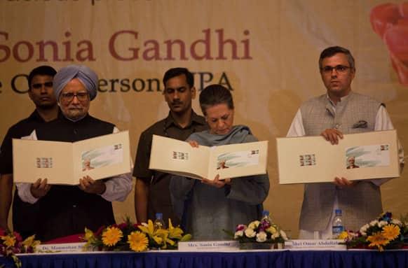Prime Minister Manmohan Singh, Congress Party President Sonia Gandhi and Chief Minster of Jammu and Kashmir Omar Abdullah release a postal stamp of Kashmiri poet Peerzada Ghulam Ahmad Mehjoor.
