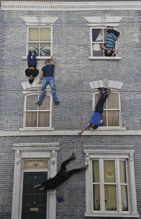 Visitors enjoy an art installation by Argentinan artist Leandro Erlich in London. Internationally known for his captivating, three-dimensional visual illusions, Argentine artist Leandro Erlich has been commissioned to create a new installation in Dalston, London.
